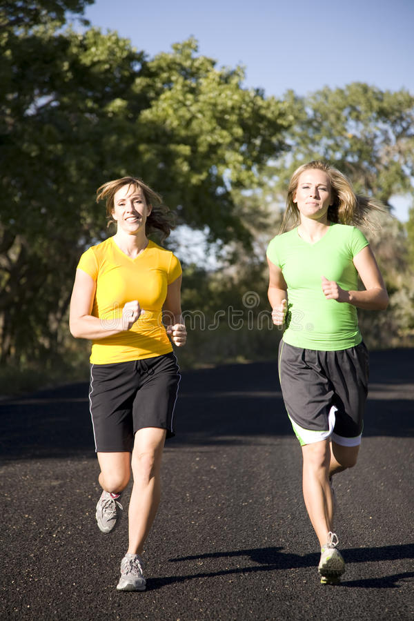 Download Women running on road stock photo. Image of yellow, friends - 11122114