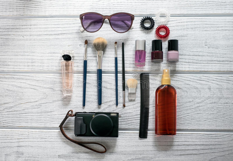 Women's accessories, cosmetics, a camera royalty free stock photos