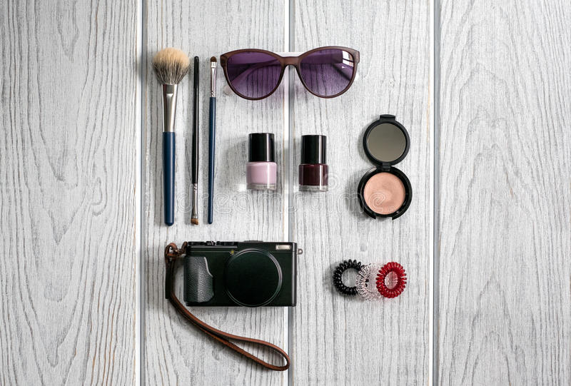 Women's accessories, cosmetics, a camera royalty free stock photography
