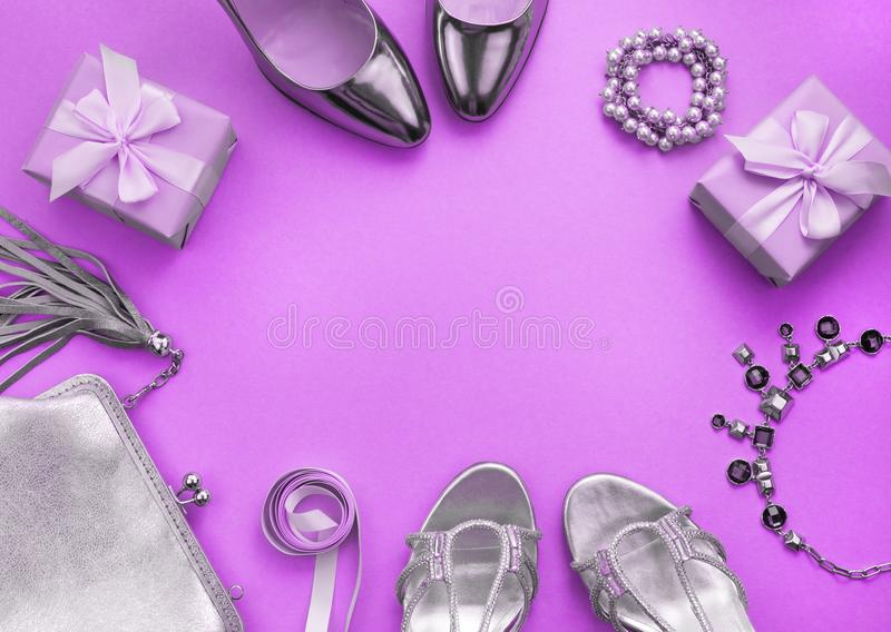 Women's accessories jewelry handbag shoes toning purple top view of Flat lay. Women's accessories jewelry handbag shoes toning purple. A top view of royalty free stock photos