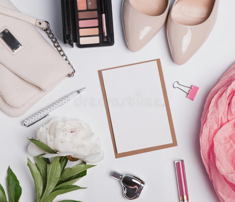 Women`s accessories on white background and blank paper royalty free stock image
