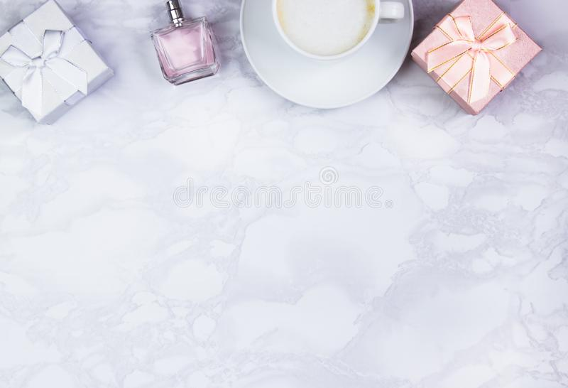 Women accessories on a white marble table. Beauty and fashion concept. Top view, flat lay, copy space royalty free stock images