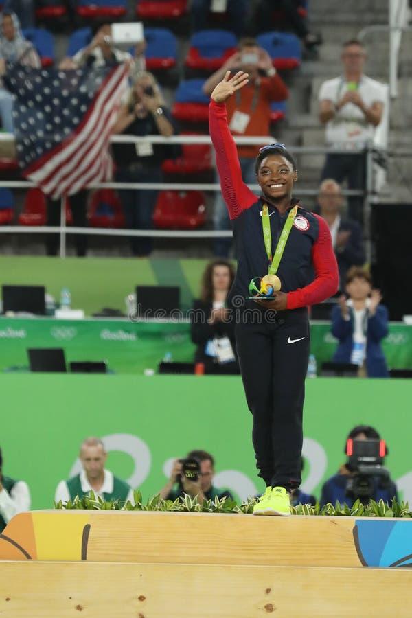 Women`s all-around gymnastics champion at Rio 2016 Olympic Games Simone Biles of Team USA during medal ceremony. RIO DE JANEIRO, BRAZIL - AUGUST 11, 2016: Women` stock images