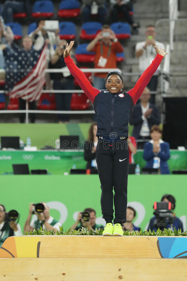 Women`s all-around gymnastics champion at Rio 2016 Olympic Games Simone Biles of Team USA during medal ceremony. RIO DE JANEIRO, BRAZIL - AUGUST 11, 2016: Women` royalty free stock images