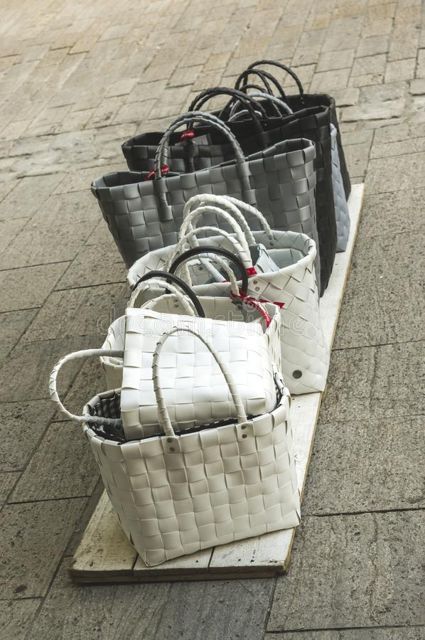Women`s bags shopping baskets for sale standing on boards on the stock images