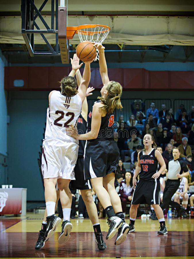 Women's Basketball. Carleton's Lindsay Shotbolt (right) blocks a shot by Ottawa's Jenna Gilbert (left) during the OUA East Final on March 2 2013 in Ottawa stock photo