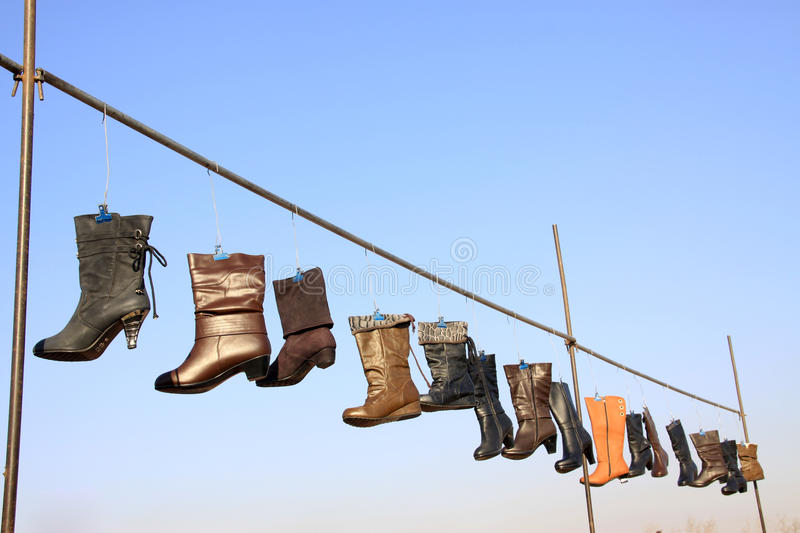 Women's boots. Hanging in the air stock photos
