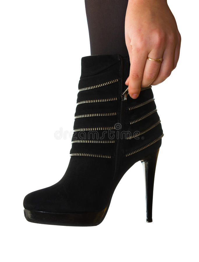 Women's boots on his leg royalty free stock photography