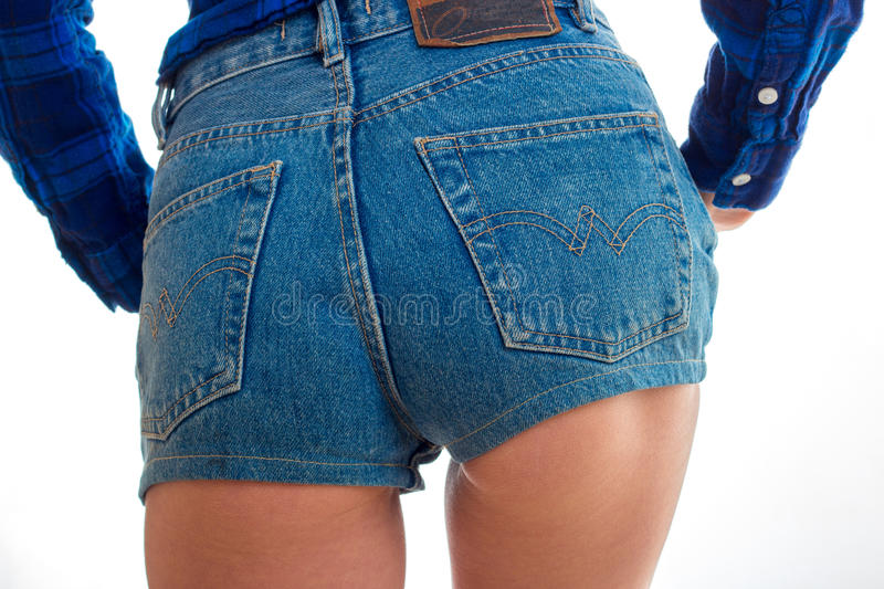 Women`s booty in denim shorts close-up stock photography