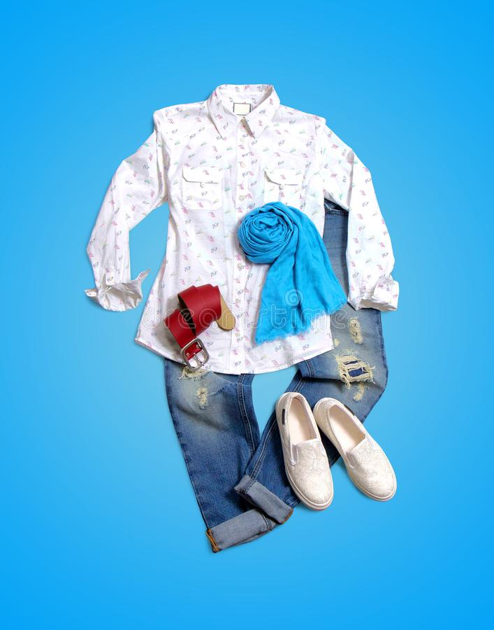 Women`s clothing collection on blue background stock photo