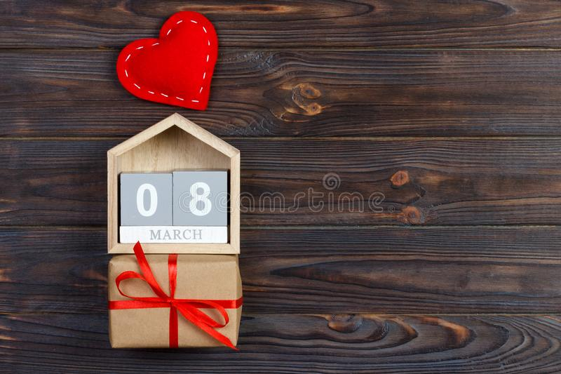 Women`s Day background with handmade small textile heart, calendar and gift box.  royalty free stock images