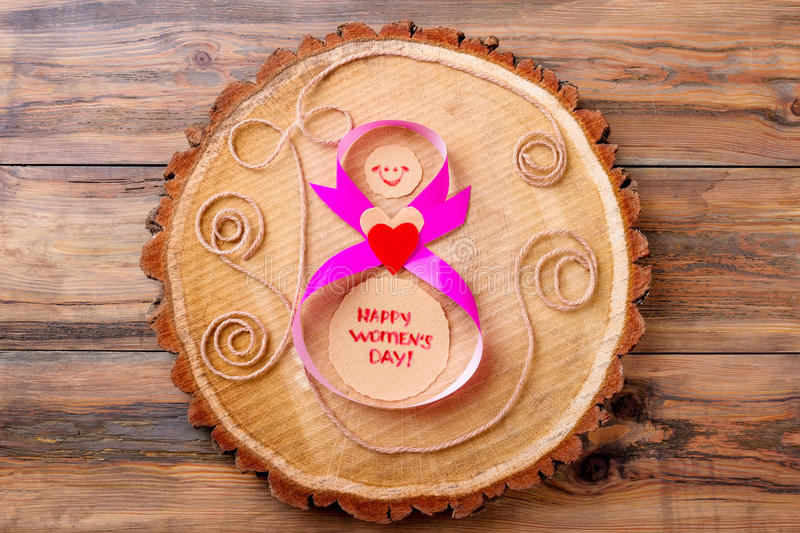 Women`s Day card on wood. royalty free stock photos