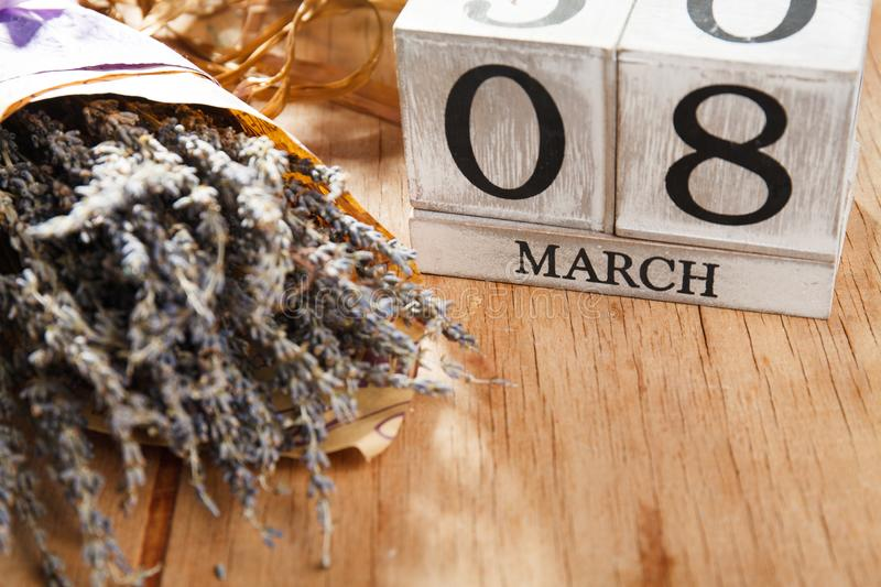 Women`s day March 8 with wooden block calendar stock photography