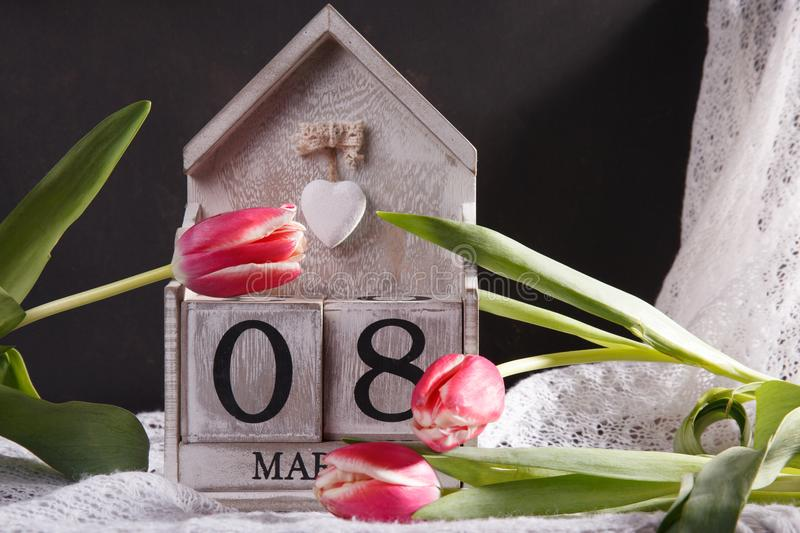 Women`s day March 8 with wooden block calendar stock image