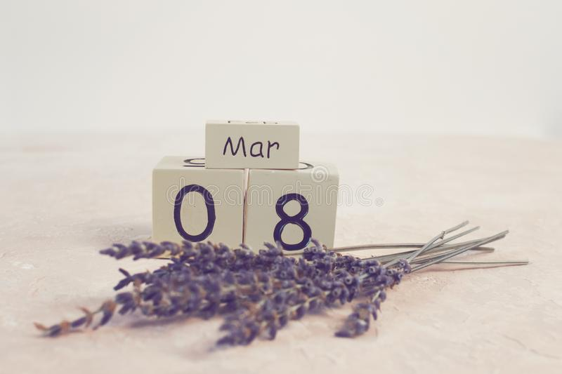 Women`s day March 8 with wooden block calendar. Happy mother`s day. Spring flower. Toned royalty free stock photo