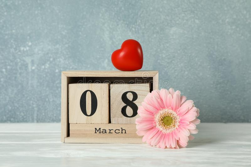Women`s day March 8 with wooden block calendar and heart. Happy mothers day. Spring flower. On white table royalty free stock photos