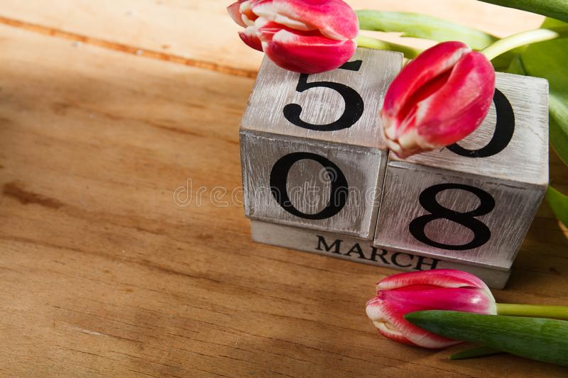 Women`s day March 8 with wooden block calendar stock photo