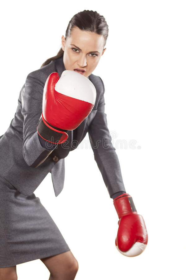 Women's defence. Serious business woman with boxing gloves on white background stock photography