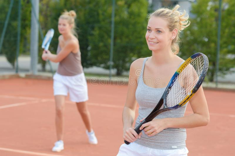 Women`s doubles tennis game. Doubles royalty free stock photography