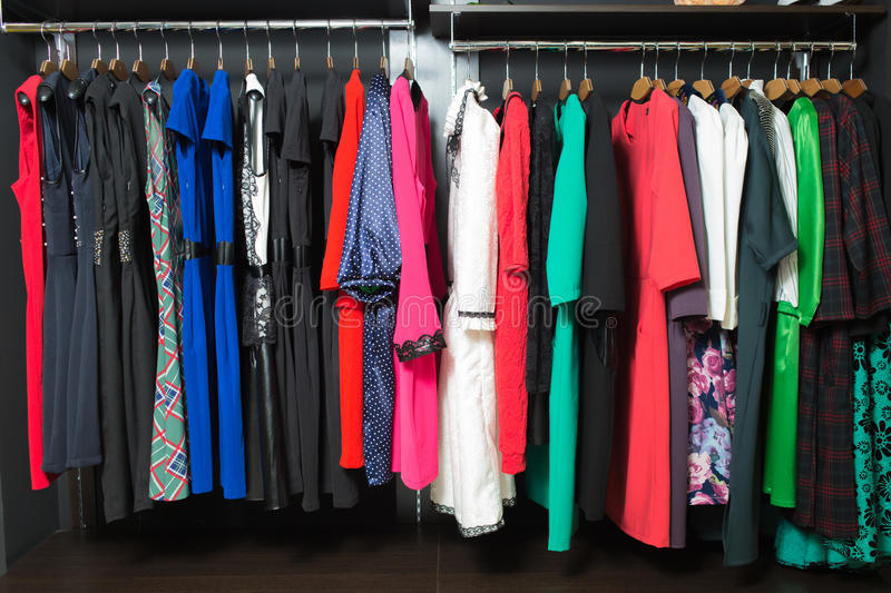Women's dresses on hangers in a retail shop royalty free stock images