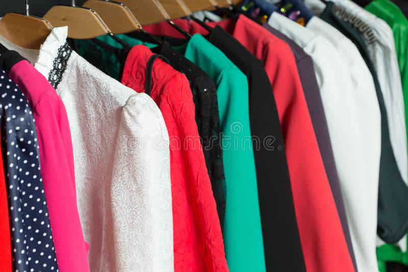 Women's dresses on hangers in a retail shop stock photography