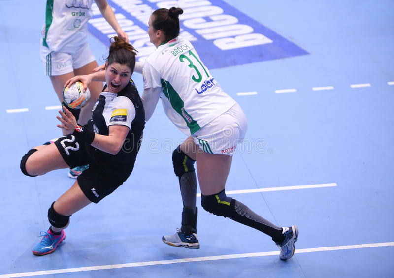 Women's EHF Champions League - CSM BUCHAREST vs GYORI AUDI ETO KC. Oana Manea from CSM Bucharest ( L ) in action during the Women's EHF Champions League match stock photography