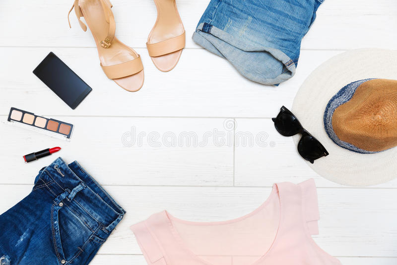 Women`s fashion clothes and accessories, top view with copy spac royalty free stock photo