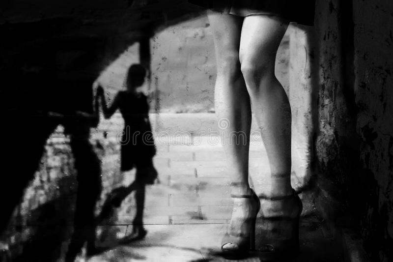 Silhouette of a woman in a dark alley of the city stock photo
