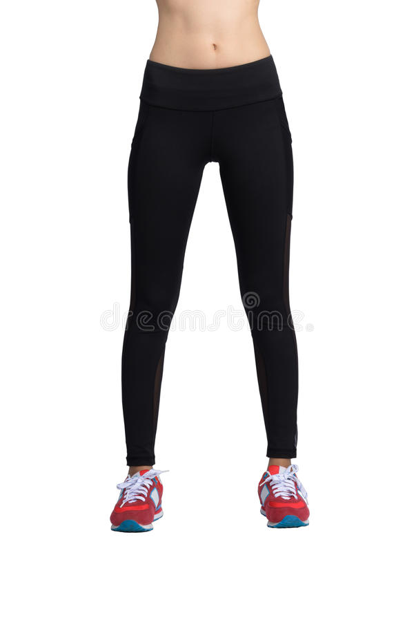 Women` s fitness pants. Women` s black fitness pant and red sport shoes on white background with clipping path. Front view stock images