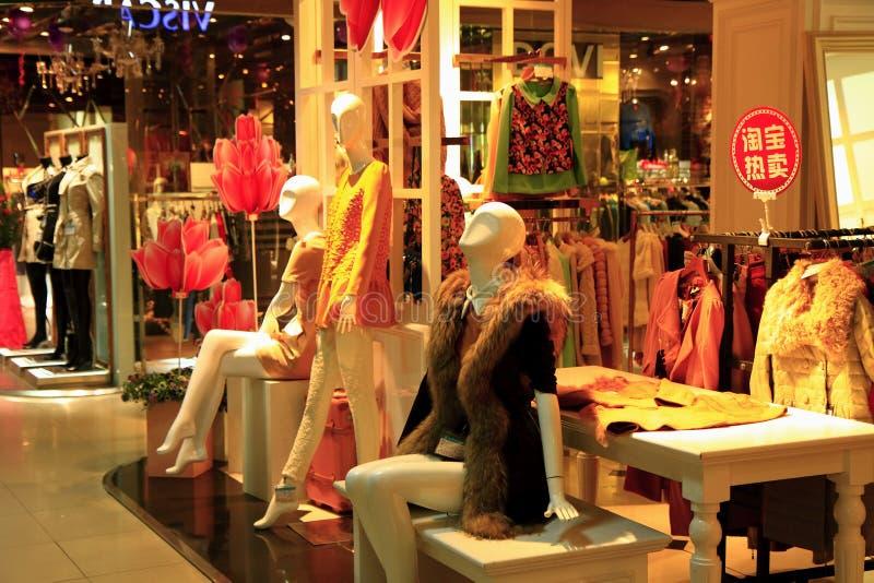 Women's garments in the department store. Eye-catching garments in the department store stock image
