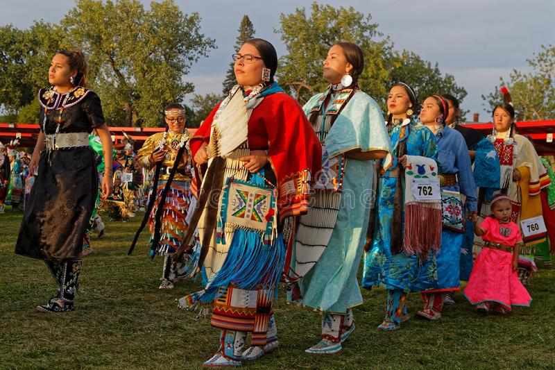 Women`s Grand Entry at 49th annual United Tribes Pow Wow. BISMARK, NORTH DAKOTA, September 8, 2018 : 49th annual United Tribes Pow Wow, one of largest outdoor stock photo