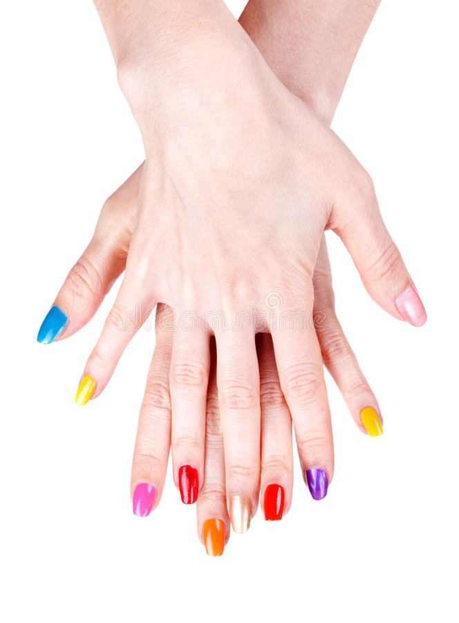 Women's hands with a colored nail polish stock images