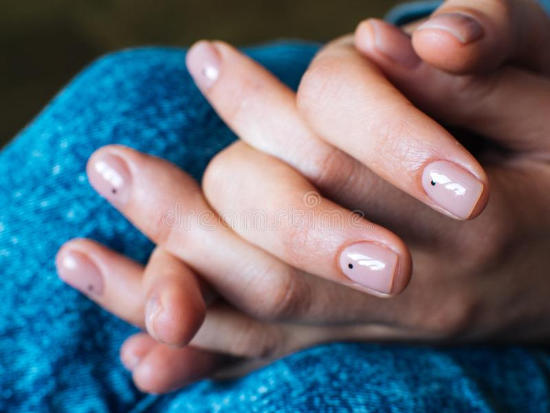 Women`s hands are locked in the lock. Nude manicure royalty free stock photos