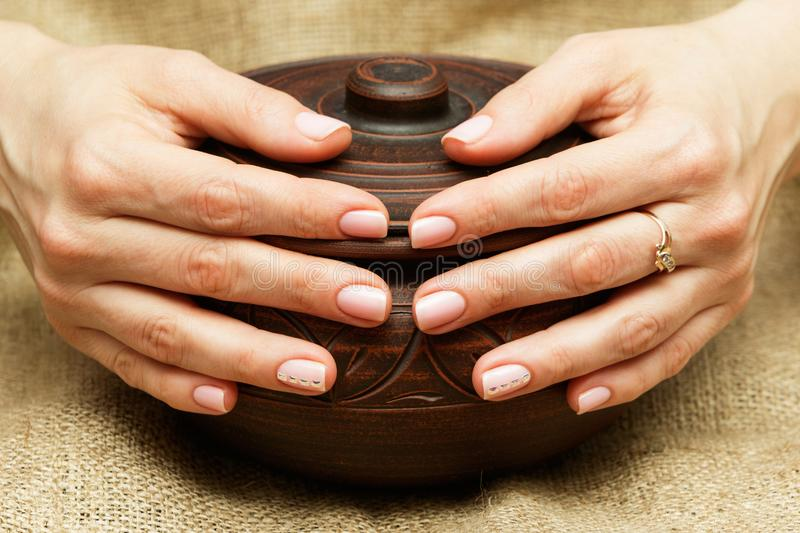 Women`s hands with utensils. Manicure royalty free stock photography