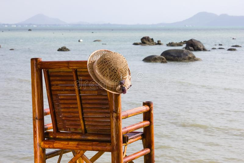 Women's hat on a bamboo chair royalty free stock photos