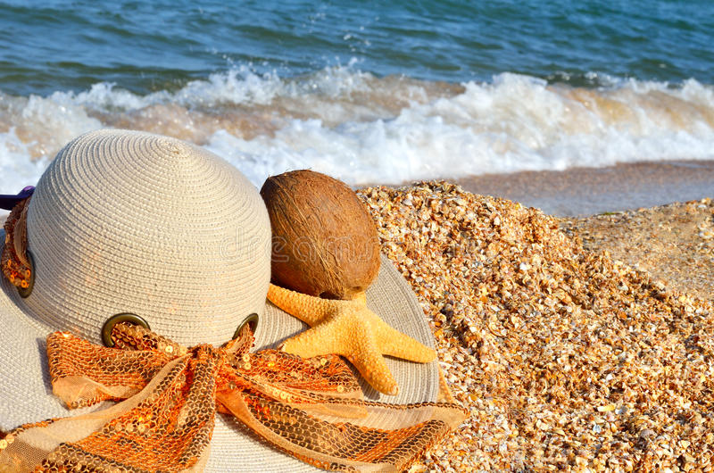 Women`s hat, coconut and starfish. royalty free stock image