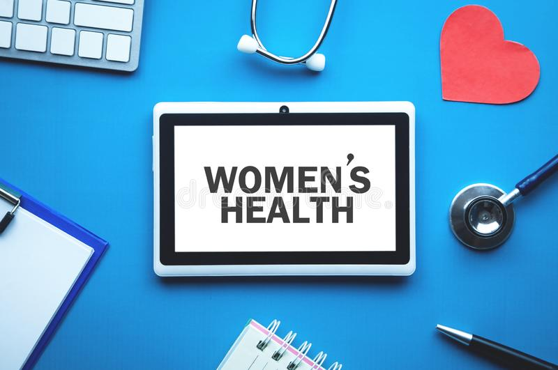 Women`s Health text on tablet screen. Medical concept royalty free stock images