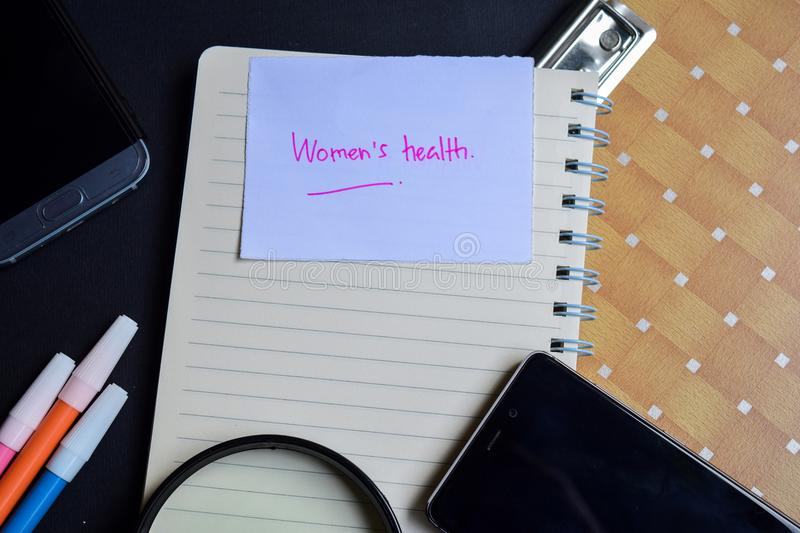 Women`s Health word written on paper. Women`s Health text on workbook, technology business concept.  stock photography
