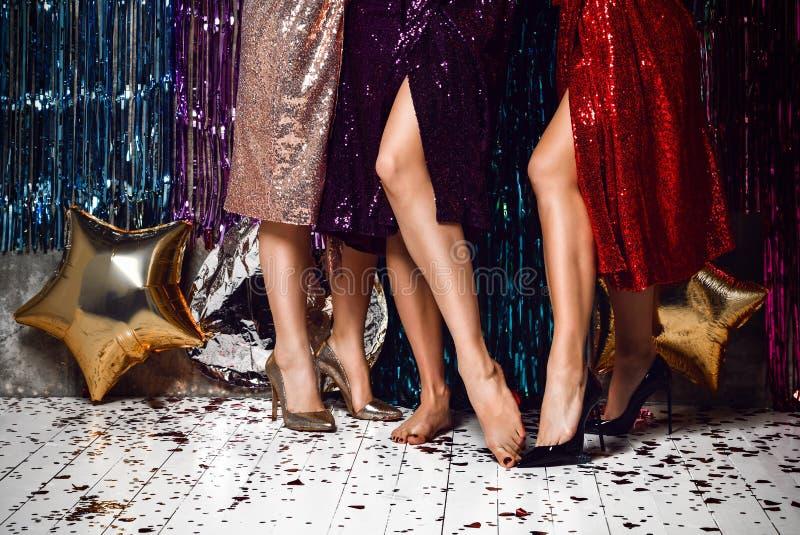 Women`s heels celebrating new year, birthday , having fun, dancing,drinking alcohol cocktails . royalty free stock image