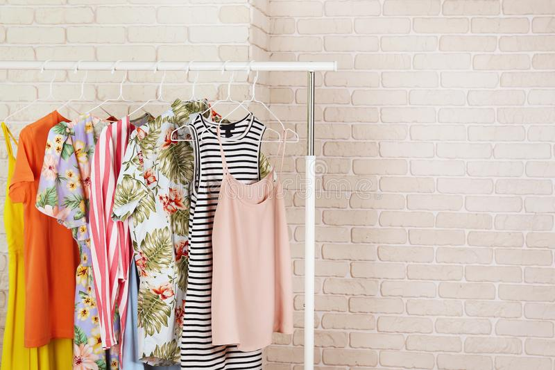 Casual clothing boutique store rack with multiple dresses. royalty free stock image