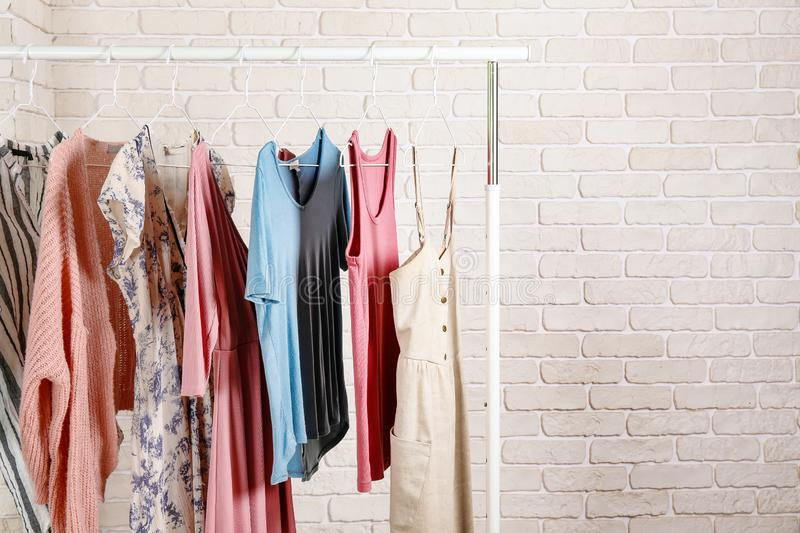Casual clothing boutique store rack with multiple dresses. stock photo