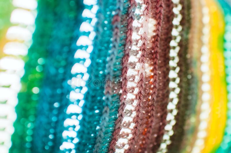 Women`s hobby. Bright crochet colorful scarf. Knitting and crocheting . Texture. Background stock images