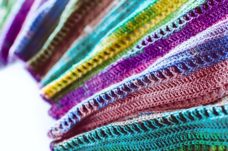 Women`s hobby. Bright crochet colorful scarf. Knitting and crocheting . Texture. Background stock photography