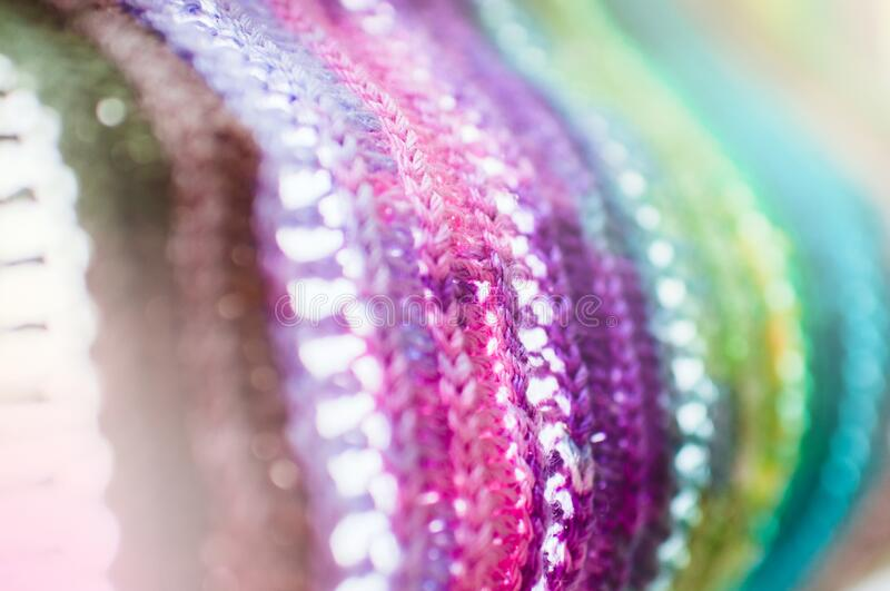 Women`s hobby. Bright crochet colorful scarf. Knitting and crocheting . Texture. Background royalty free stock image