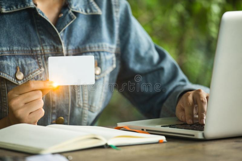 Women`s is holding white business card for contact works. royalty free stock photos