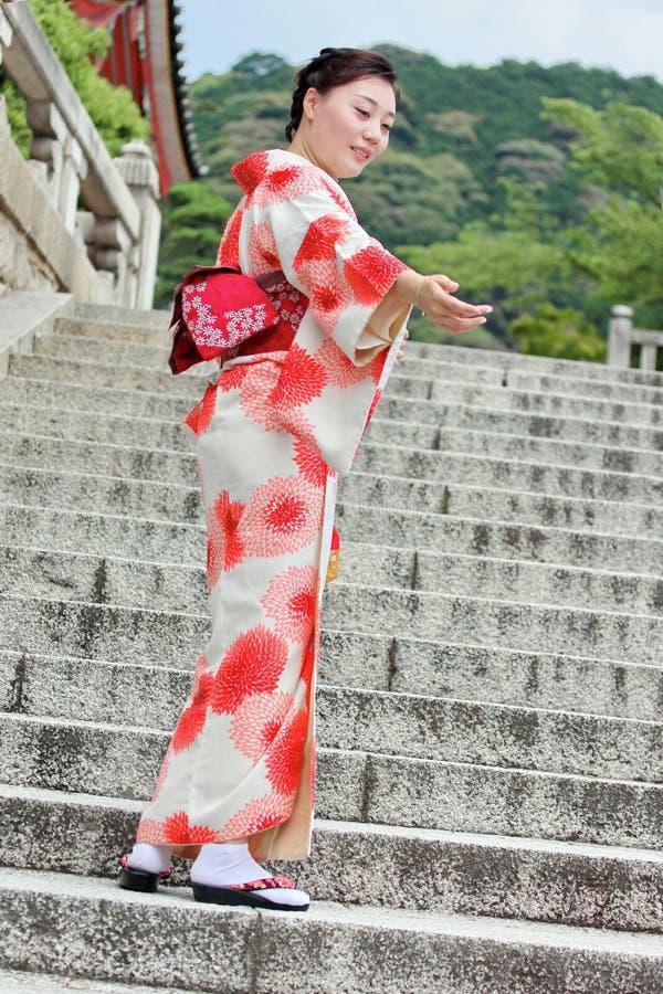 Women`s kimonos post for photo within Fushimi Inari shrine. Kyoto,Japan-June 26 ,Women`s kimonos post for photo within Fushimi Inari shrine on June 26,2016 in stock photo