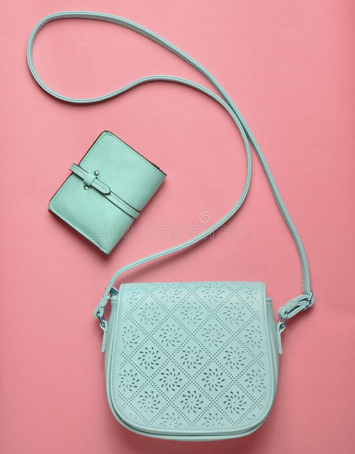 Women's leather bag and purse on a blue pastel background, women. 's accessories, top view, minimalism stock photos