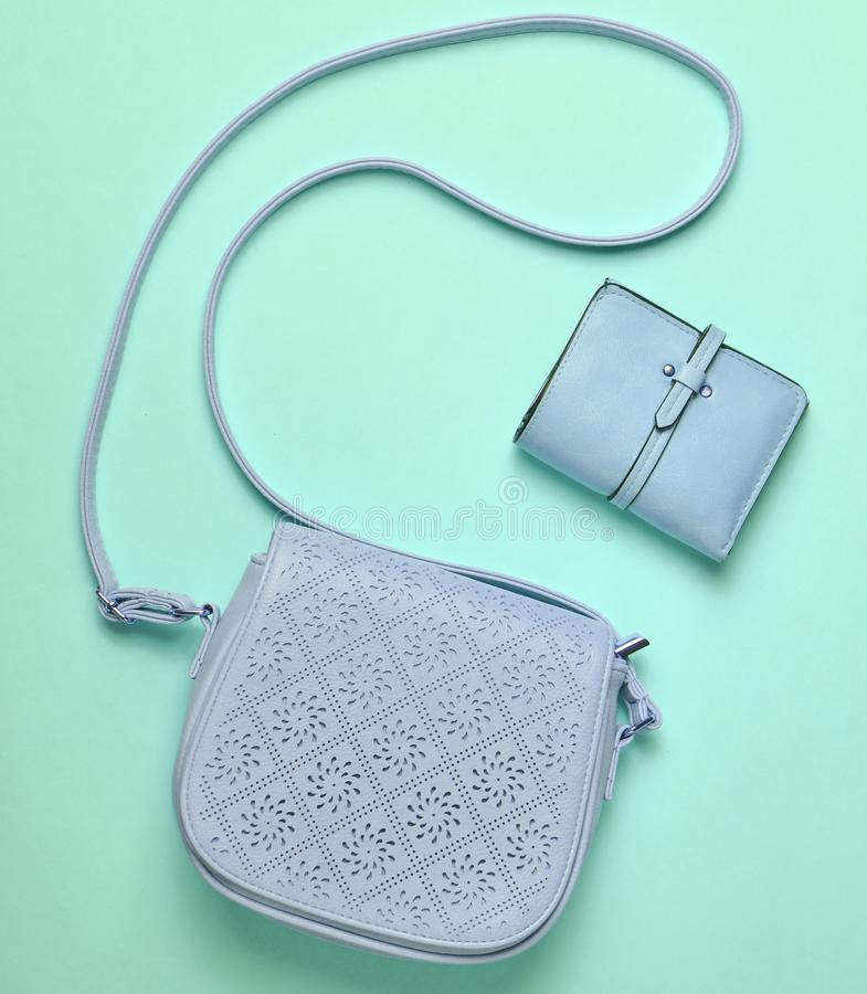 Women's leather bag and purse on a pink pastel background, women. 's accessories, top view, minimalism stock image