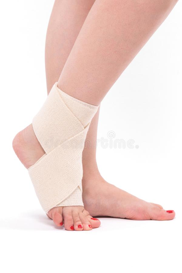 Women`s leg tied with an elastic bandage, ankle foot royalty free stock image