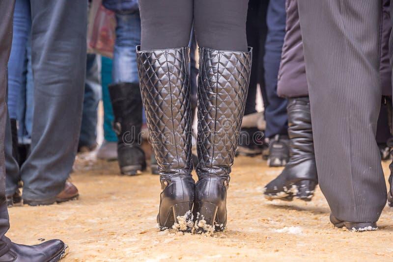 Women`s legs in boots stock photos